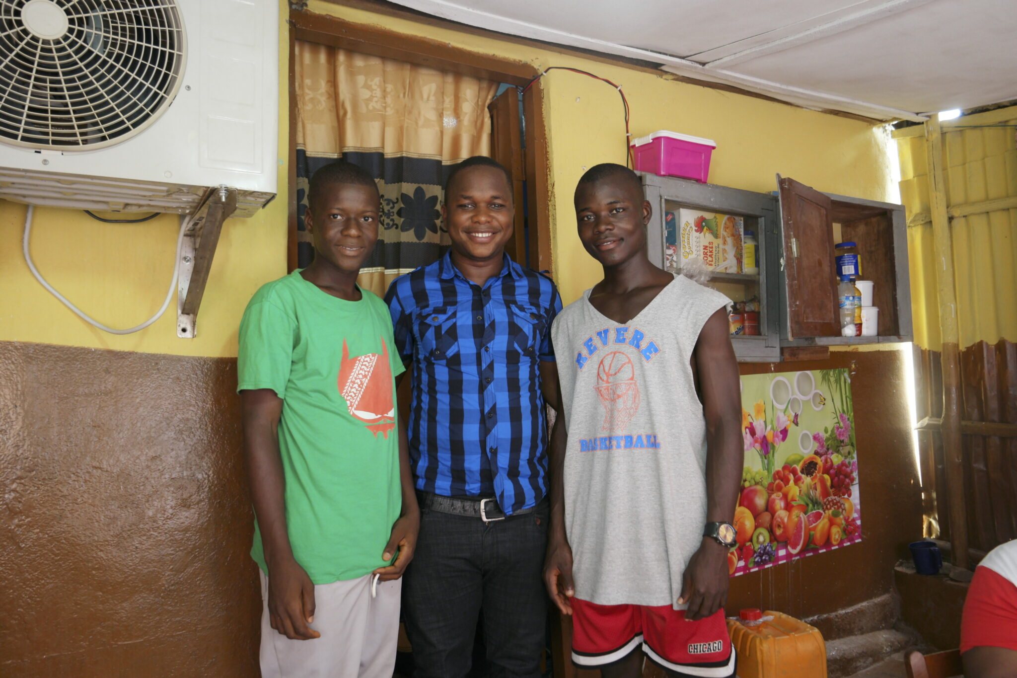 Lahai Kargbo, the director of Crossroads Sierra Leone, has welcomed orphaned boys into his home.