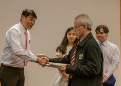 Crossroads Student David Receives Baptism Certificate from Elder Ho Peng Kee